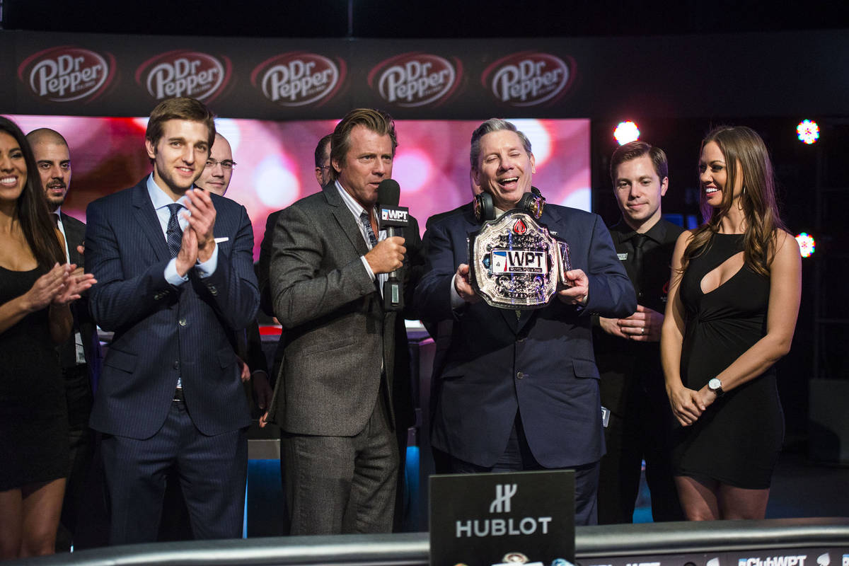 Mike Sexton receives his champion's belt after winning a World Poker Tour event in Montreal in ...