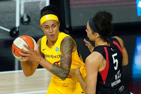 Indiana Fever forward Candice Dupree (4) works against Las Vegas Aces forward Dearica Hamby (5) ...