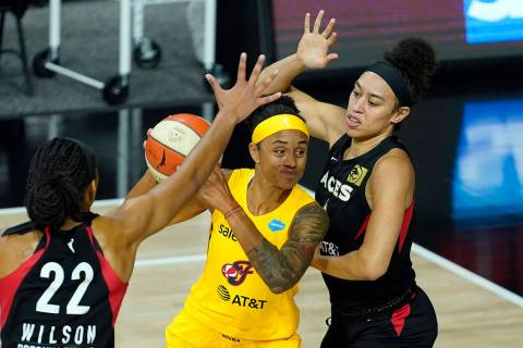 Indiana Fever forward Candice Dupree (4) shoots between Las Vegas Aces forward Dearica Hamby (5 ...