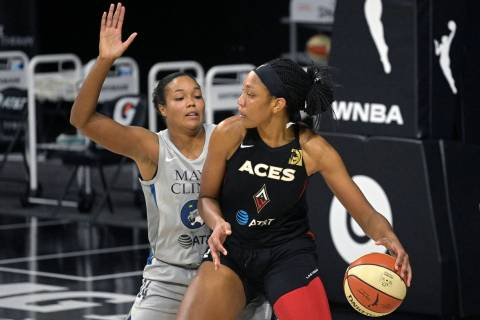 Las Vegas Aces center A'ja Wilson backs into position in front of Minnesota Lynx forward Naphee ...