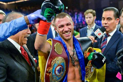 Vasiliy Lomachenko smiles after defeating Jose Pedraza in a WBO title lightweight boxing match ...
