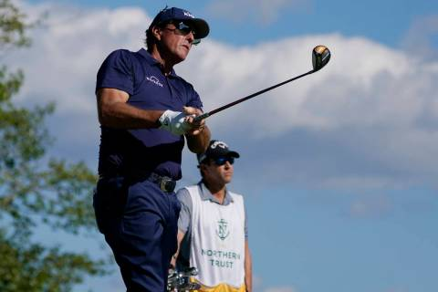 PhilMickelson watches his tee shot on the 17th hole in the first round of the Northern Tr ...