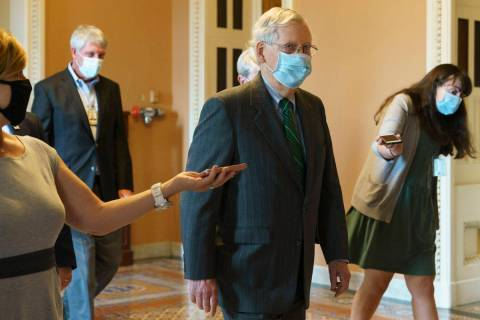 Senate Majority Leader Mitch McConnell of Ky., center, walks to his office from the Senate floo ...