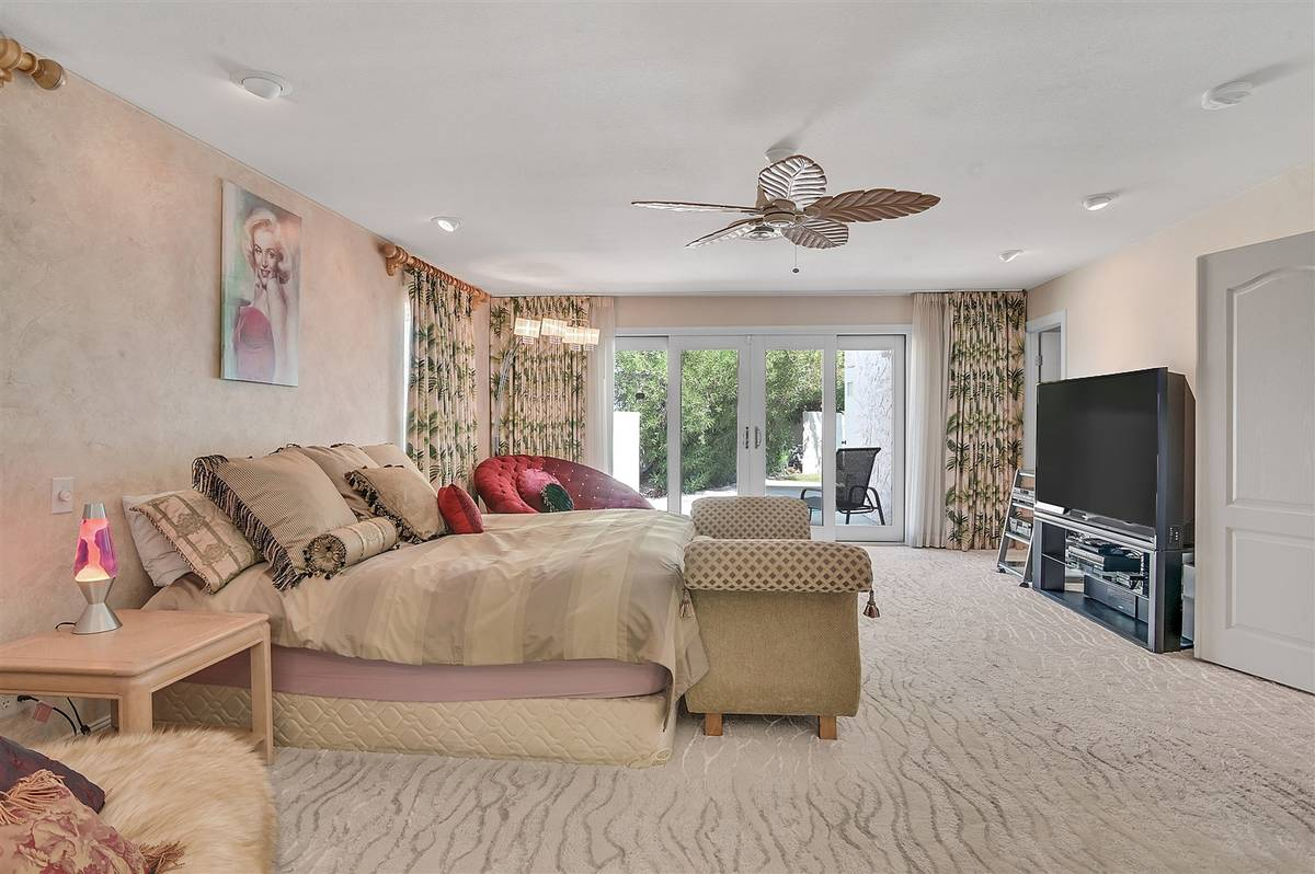 The master bedroom was expanded and remodeled. It opens to the pool area. (Nartey Wilner Group)