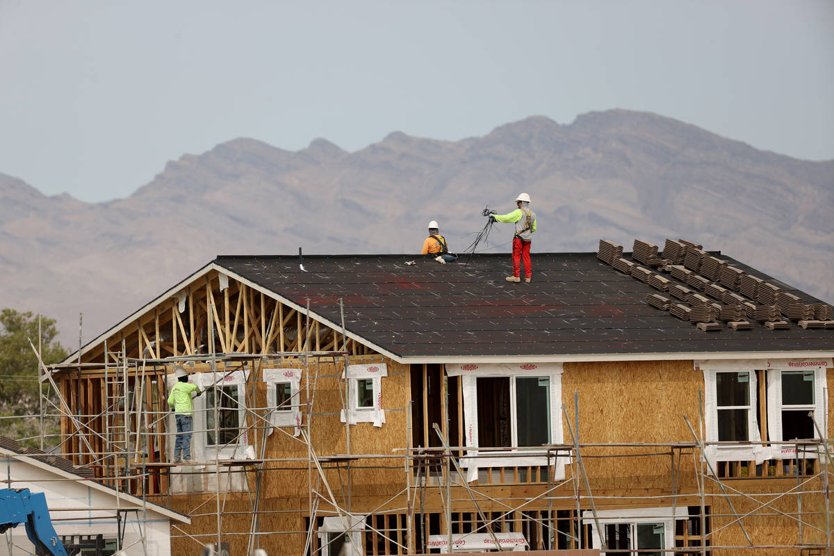 Workers on the roof of a home under construction in the Beazer Homes community in Indian Spring ...
