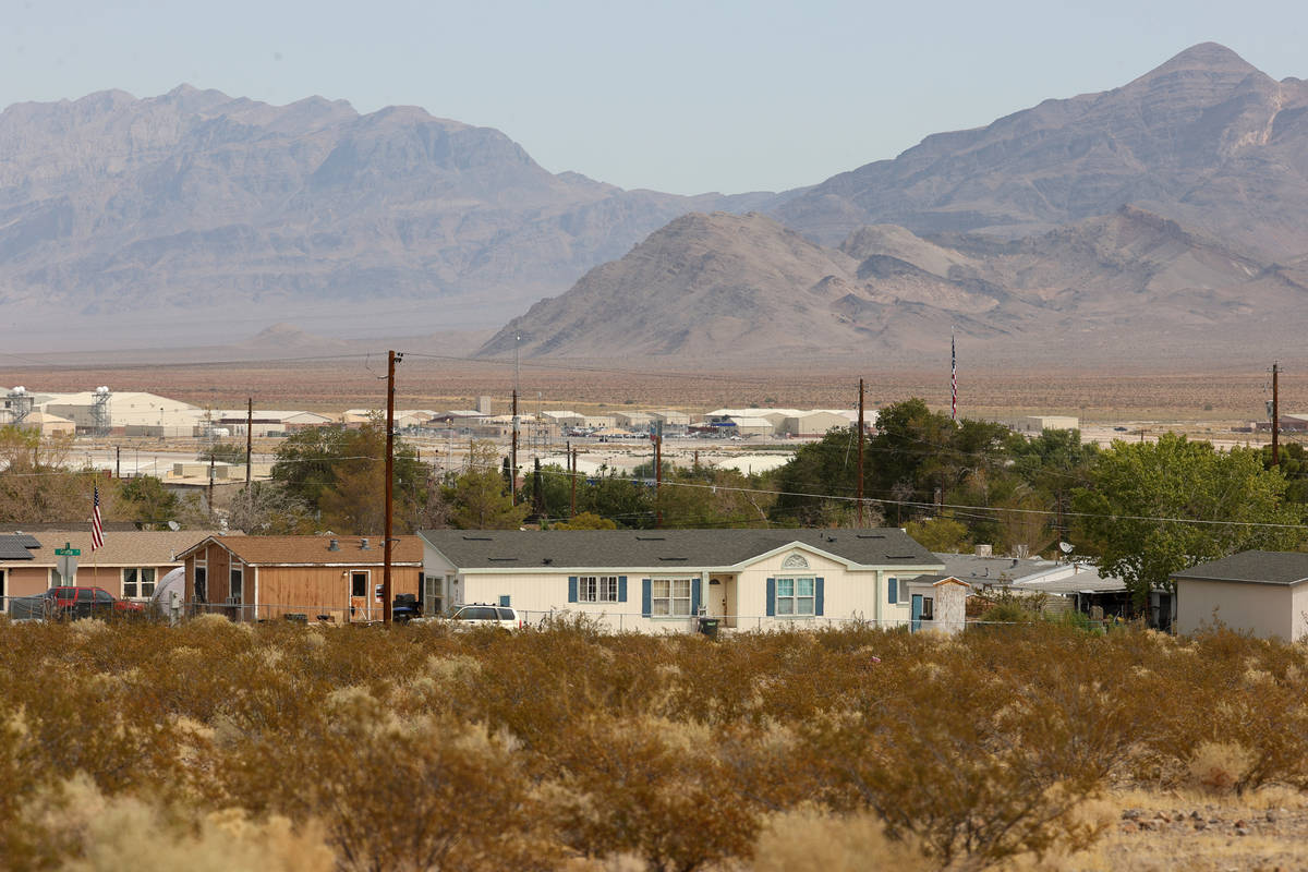 Creech Air Force Base is seen in the distance behind mobile homes at Indian Springs, Friday, Se ...