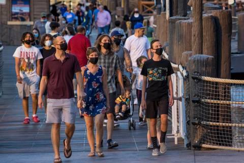 This August 7, 2020, file photo shows visitors on the Las Vegas Strip. (L.E. Baskow/Las Vegas R ...