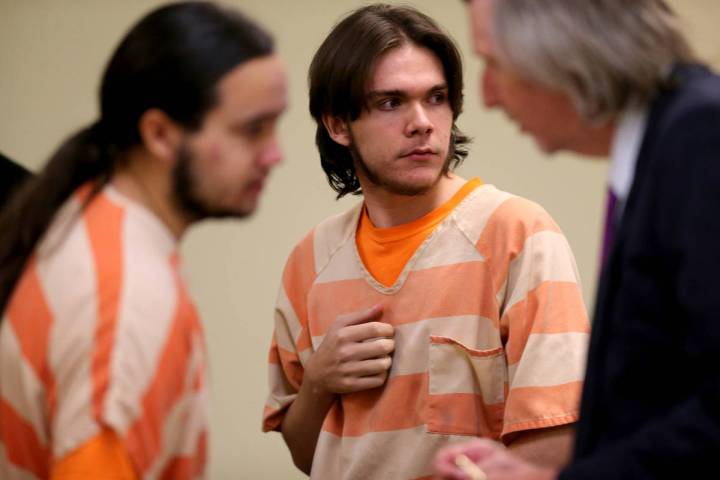 Michael Wilson, center, during a break in a preliminary hearing in Pahrump Justice Court Thursd ...