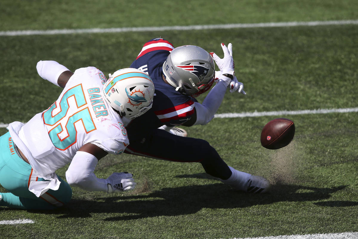 New England Patriots wide receiver N'Keal Harry (15) fumbles the ball through the end zone afte ...