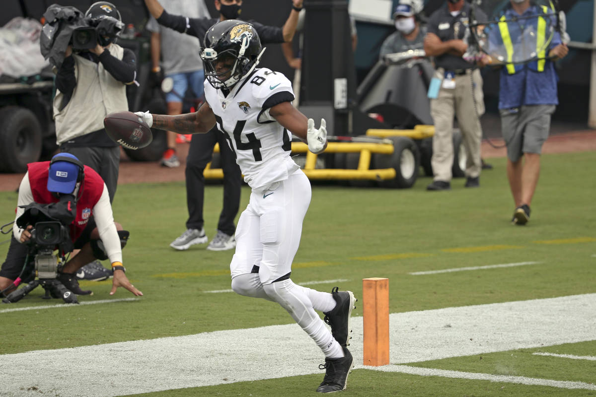 Jacksonville Jaguars wide receiver Keelan Cole scores a touchdown off a 22-yard pass play again ...