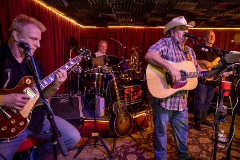 Owner Bobby Kingston, right, sings and plays with his band on the final night before Saddle N S ...