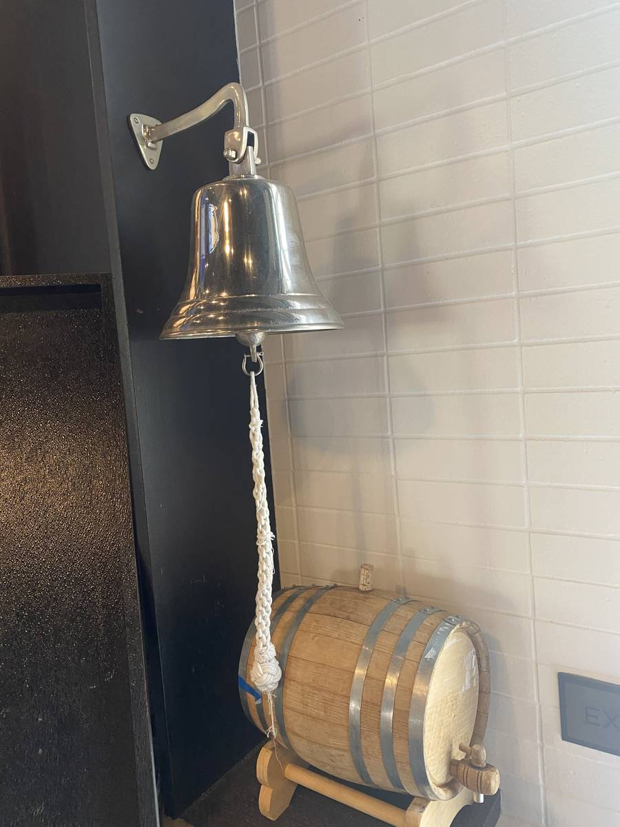 A bell that rings after every Vegas Golden Knights goal is shown at Wolfgang Puck's Players Loc ...