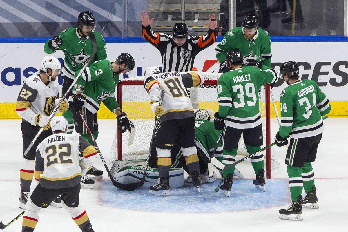 The referee calls a no goal as Dallas Stars and Vegas Golden Knights players look toward the ne ...