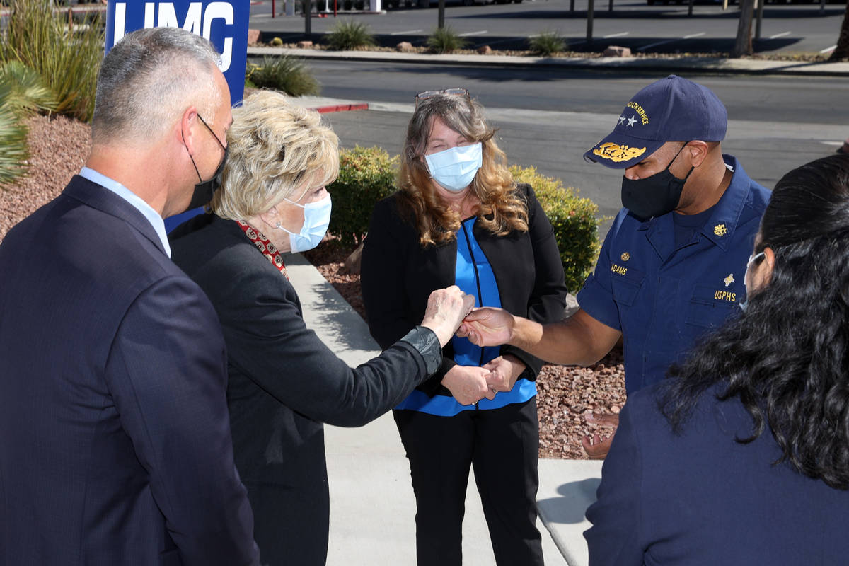 Mayor Carolyn Goodman, left, gifts a poker chip to Vice Admiral Jerome M. Adams, U.S. Surgeon G ...