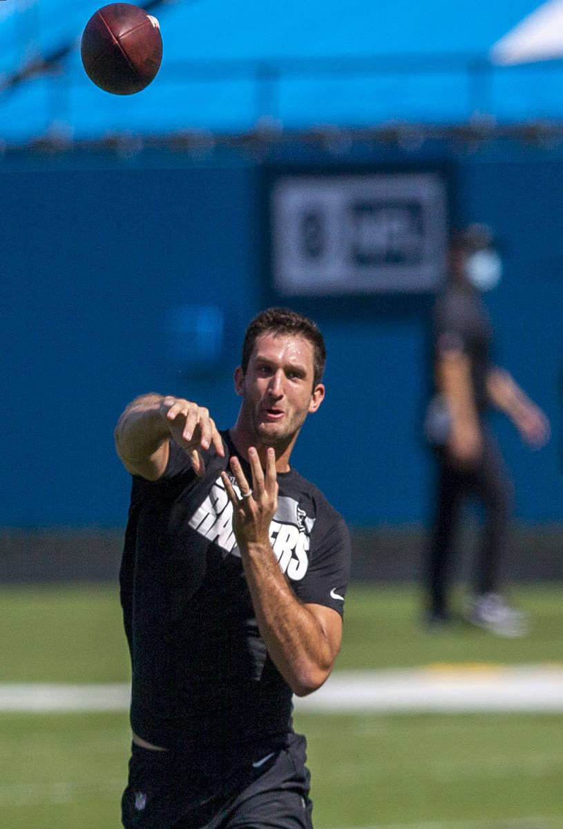 Las Vegas Raiders quarterback Nathan Peterman throws the football before an NFL football game a ...