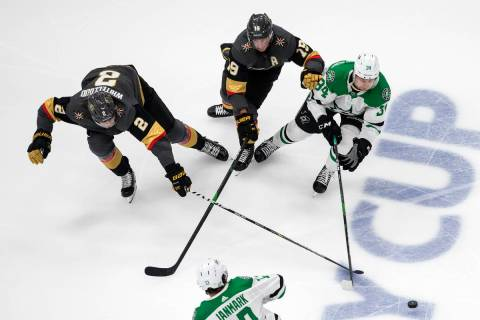 Dallas Stars' Denis Gurianov (34), Vegas Golden Knights' Reilly Smith (19) and Golden Knights' ...