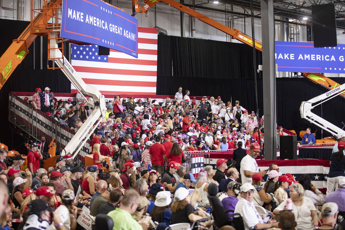 A large crowd waits for President Donald Trump at a campaign rally at Xtreme Manufacturing in H ...