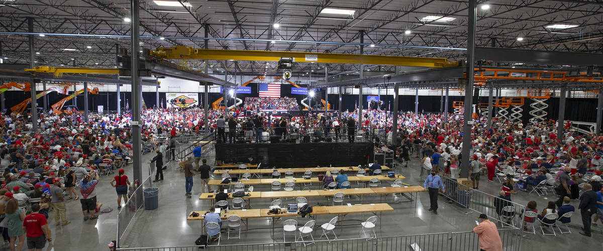 An Xtreme Manufacturing facility is packed with Trump campaign rally attendees on Sunday, Sept. ...