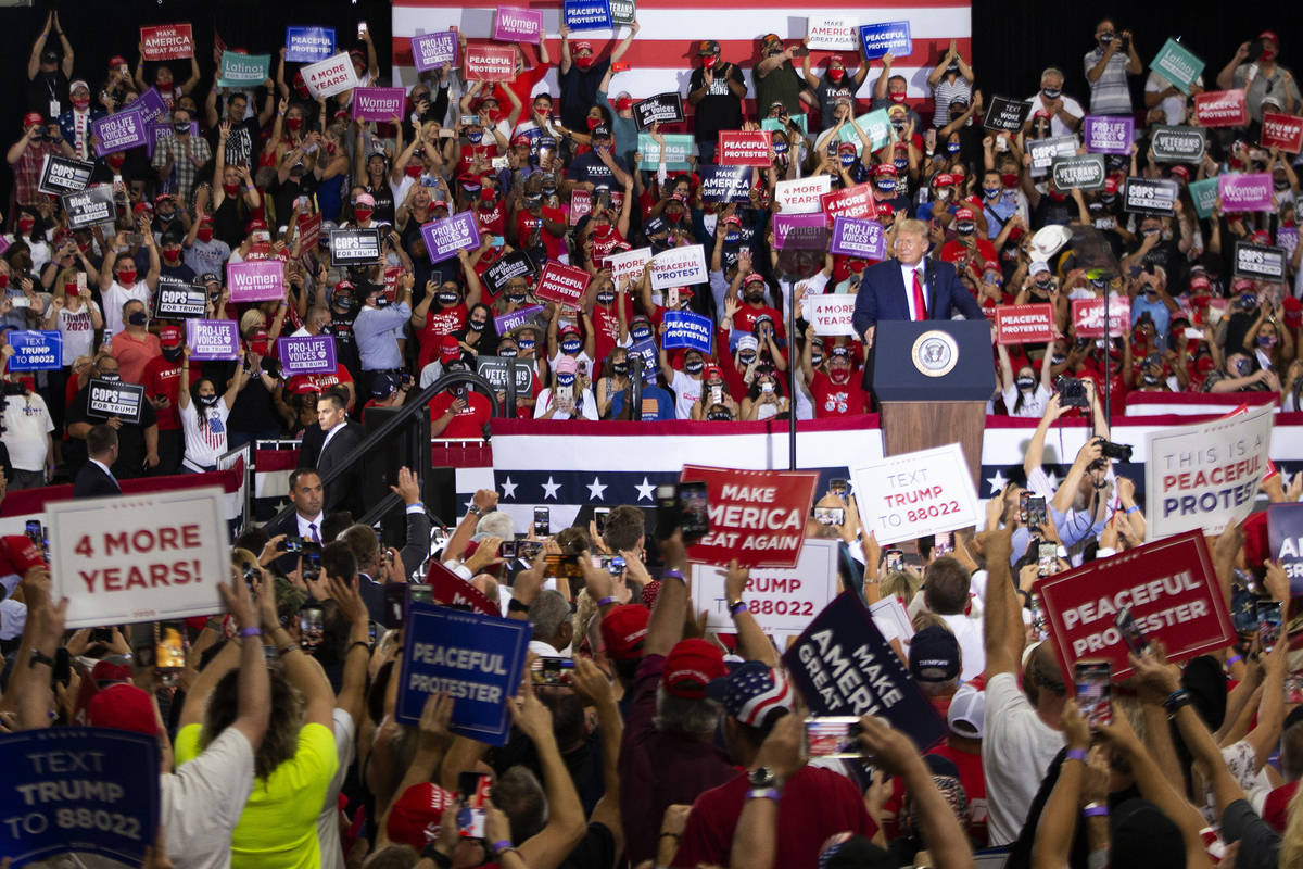 The crowd goes wild at a campaign rally for President Donald Trump at Xtreme Manufacturing on S ...