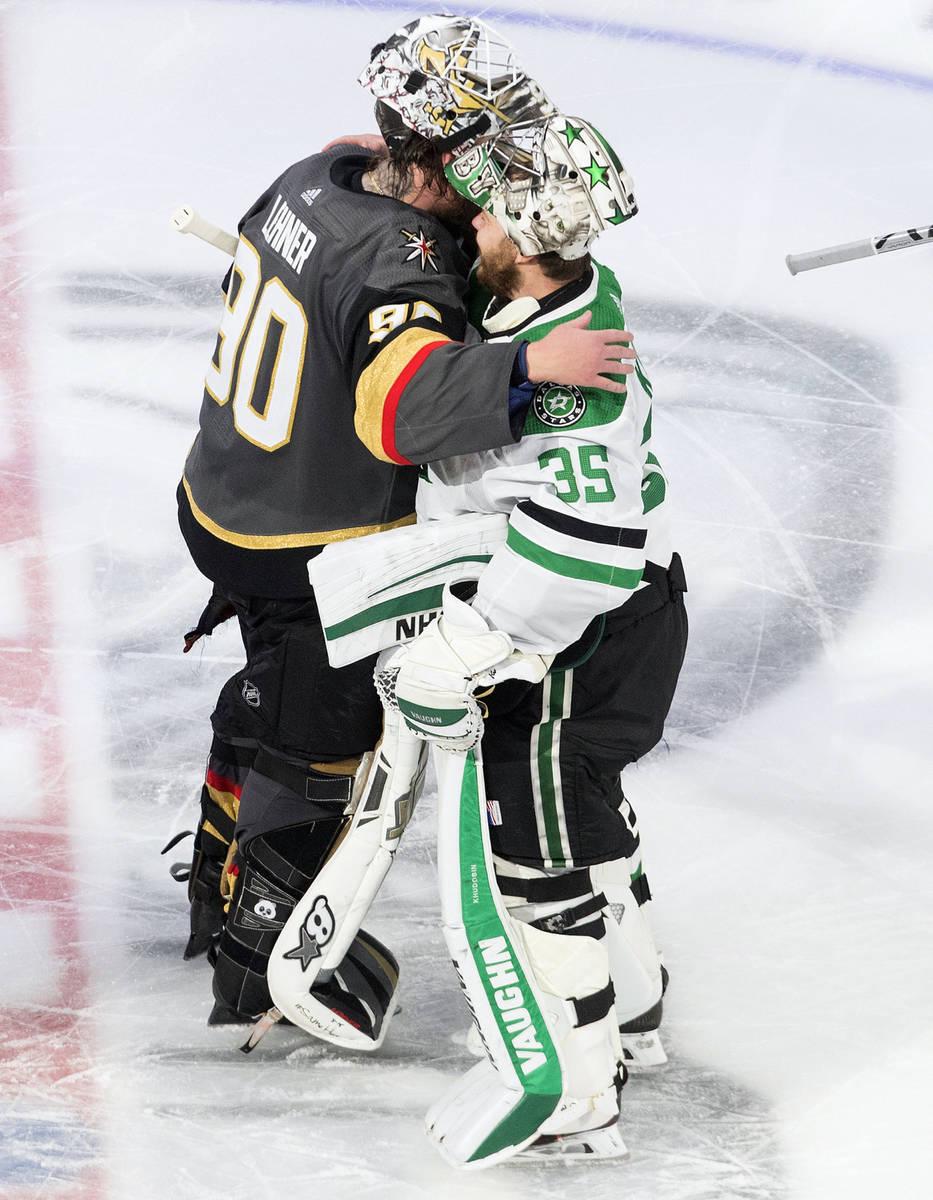 Dallas Stars goalie Anton Khudobin (35) and Vegas Golden Knights goalie Robin Lehner (90) hug a ...