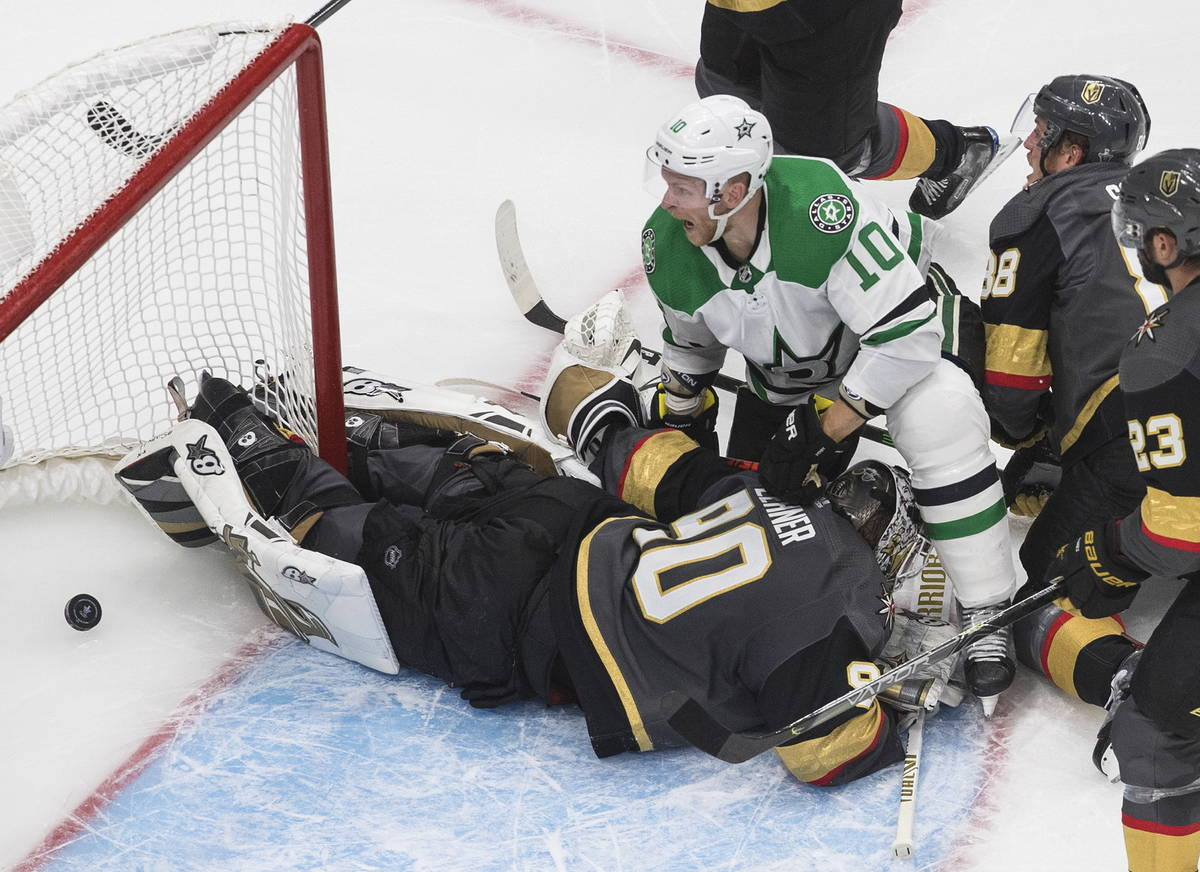 Dallas Stars' Corey Perry (10) watches the puck go into the net past Vegas Golden Knights goali ...