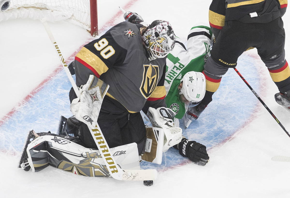 Dallas Stars' Corey Perry (10) reaches for the puck as Vegas Golden Knights goalie Robin Lehner ...