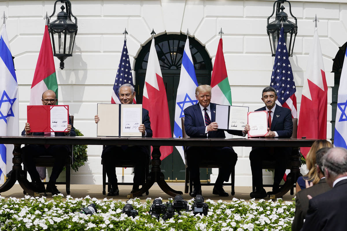 President Donald Trump, center, with from left, Bahrain Foreign Minister Khalid bin Ahmed Al Kh ...