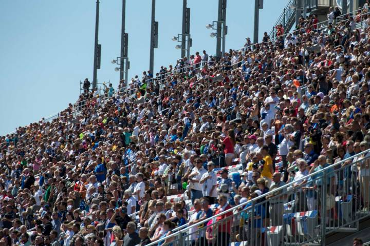 Race fans watch the South Point 400 NASCAR Cup Series auto race at the Las Vegas Motor Speedway ...