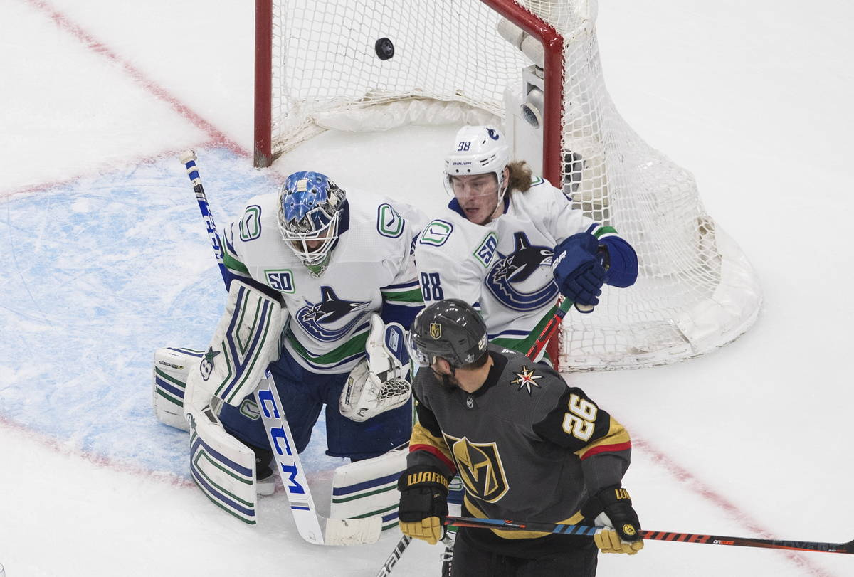 Vancouver Canucks goalie Thatcher Demko (35) makes a save as Vegas Golden Knights' Paul Stastny ...