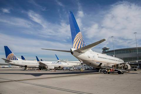 Aircraft line the tarmac at the United Airlines terminal at McCarran International Airport on T ...