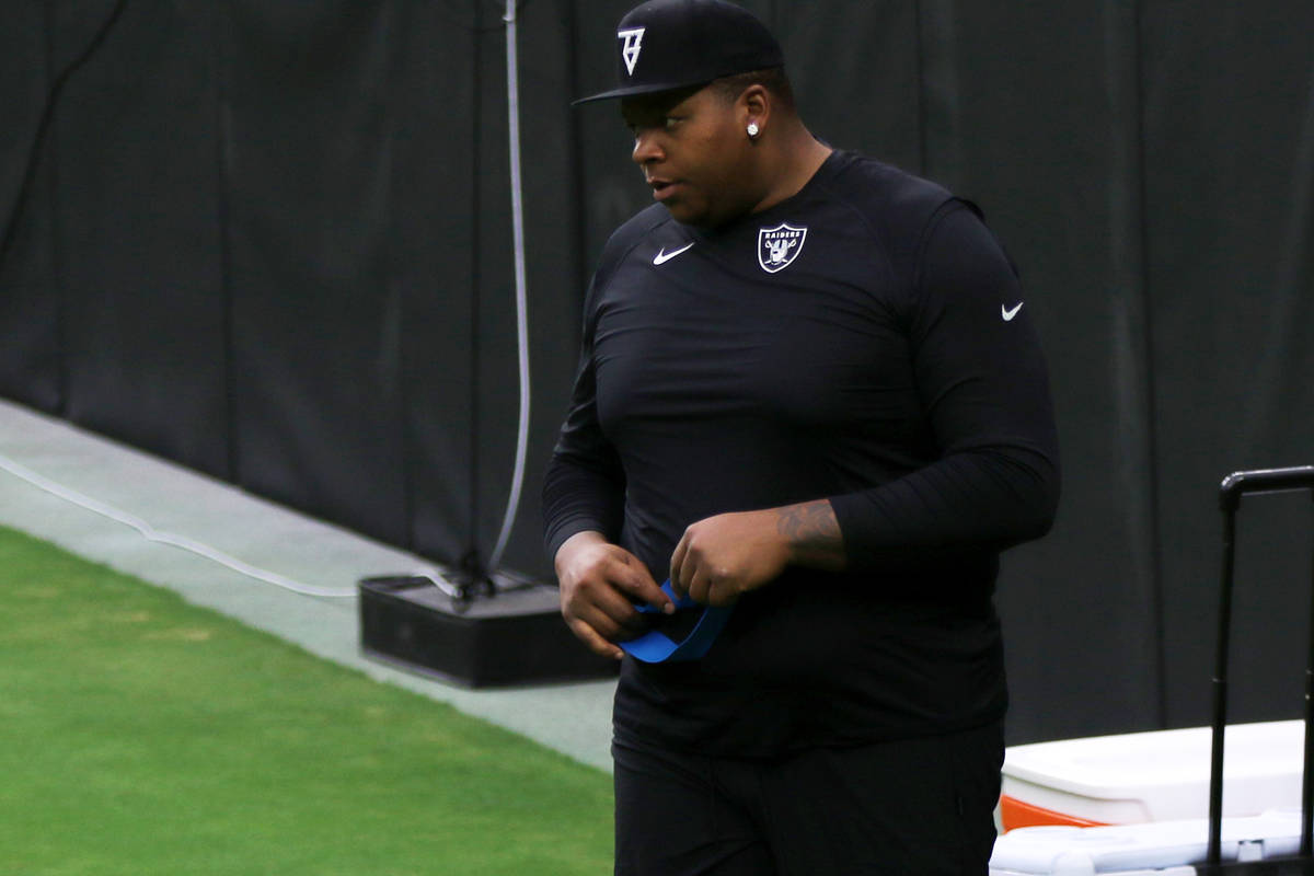 Las Vegas Raiders offensive tackle Trent Brown looks on during a team practice at Allegiant Sta ...