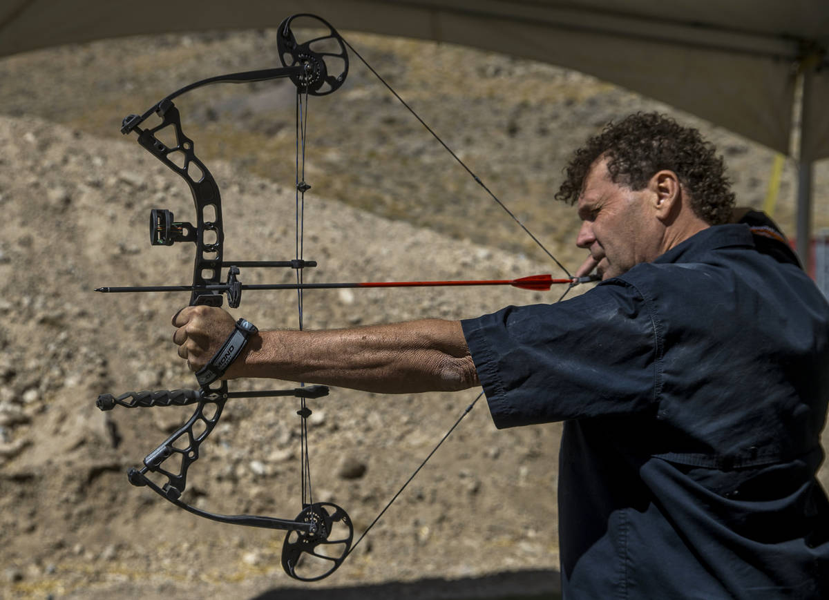 Adrenaline Mountain owner and CEO Eric Brashear eyes a target while using a compound bow, Thurs ...