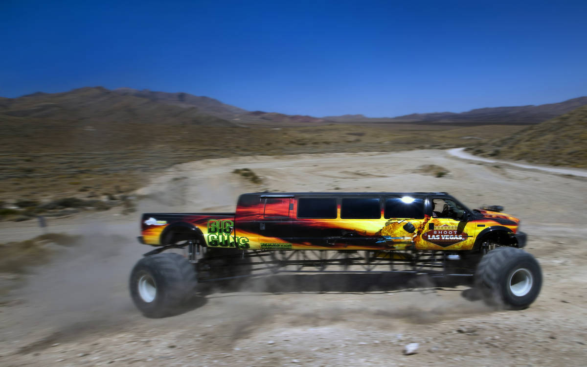 BIG GUNS, the world's longest monster truck, churns up some dirt while navigating a hill at Adr ...