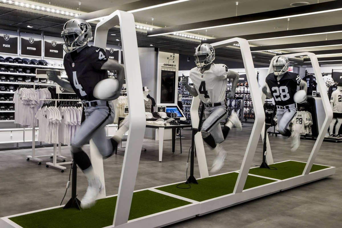 A robotic trio of runners on display within The Raider Image official team store inside of Alle ...