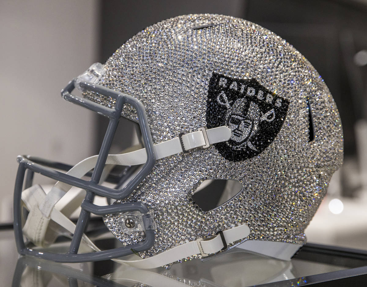 A crystal-covered RaiderÕs helmet for $7700 can be purchased at The Raider Image official ...