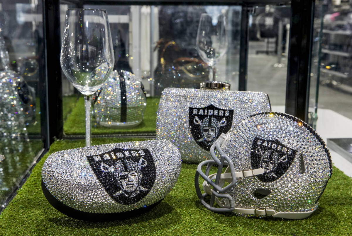 Crystal covered merchandise can be purchased at The Raider Image official team store inside of ...