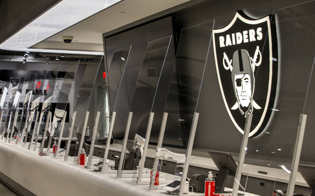 Th cashier areas are COVID-19 safe with plexiglass within The Raider Image official team store ...