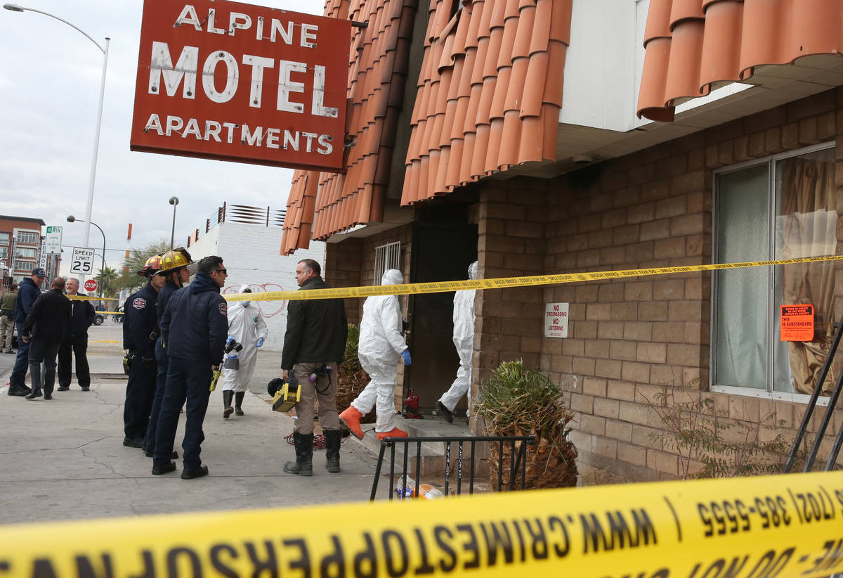 Las Vegas Fire Department investigators with assistance from Las Vegas police enter the Alpine ...