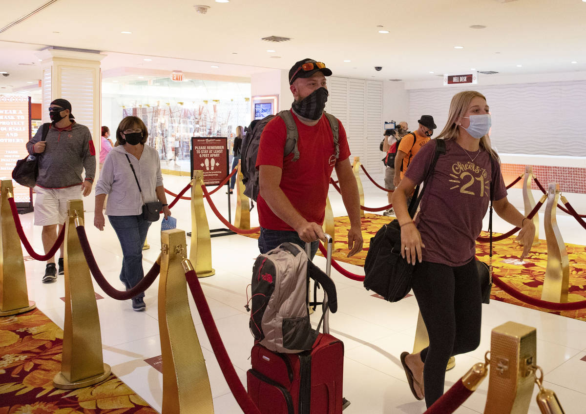 Gusts lined up to check in after the Tropicana hotel-casino reopens to public, on Thursday, Sep ...