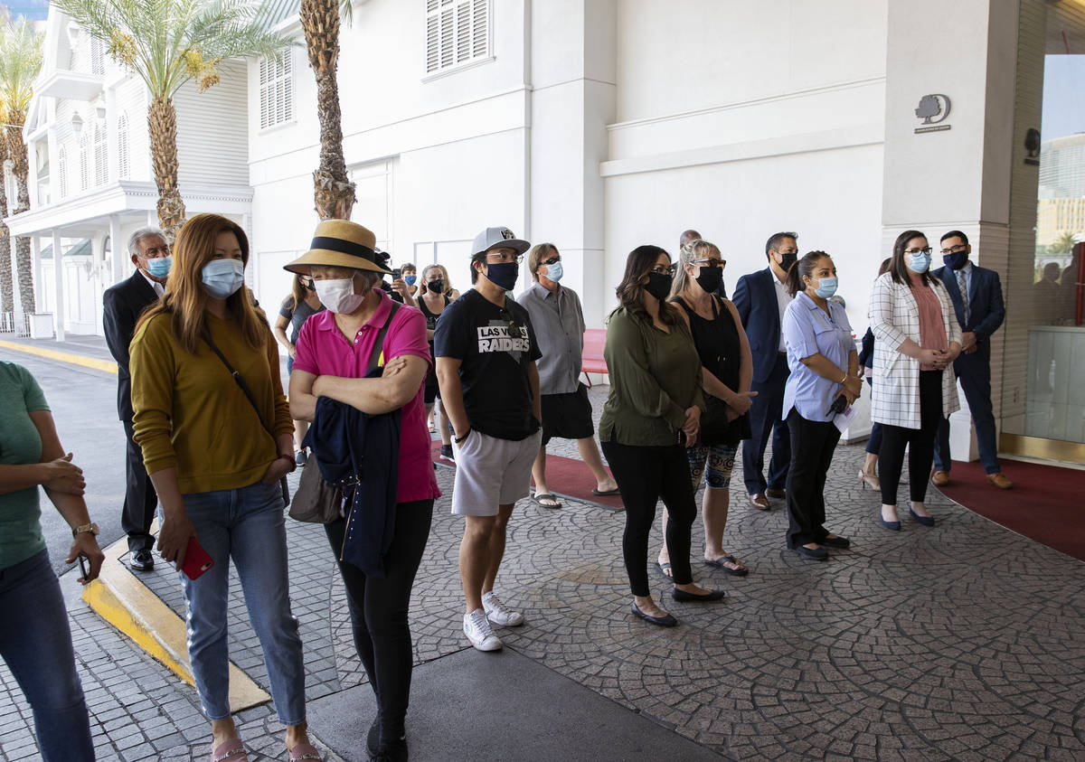 Gusts and employees wait as the Tropicana hotel-casino reopens to public, on Thursday, Sept. 17 ...