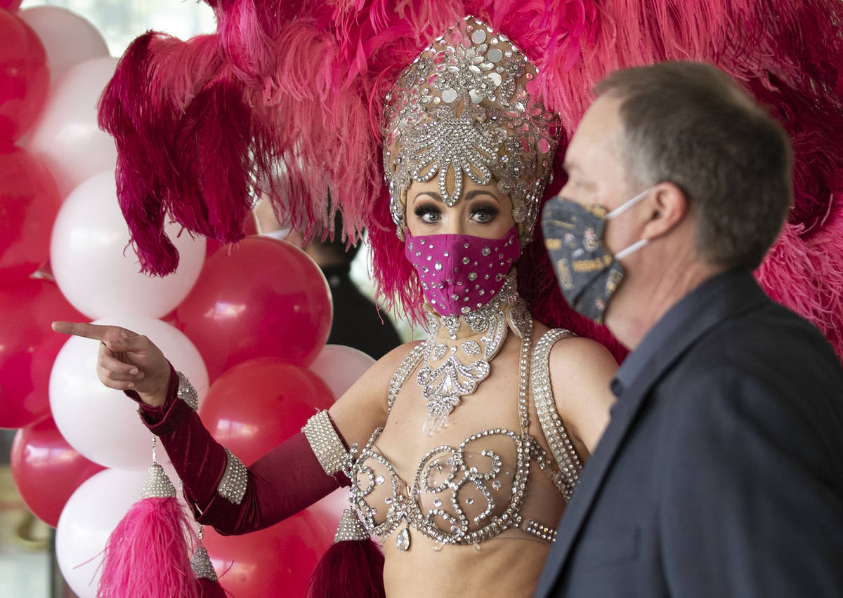 Show girl Kaleigh Jones, left, and Andy Swenson, vice president of marketing, chat as they prep ...