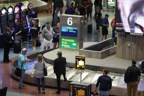Passengers wait for their luggage in Terminal 1 at McCarran International Airport in Las Vegas, ...