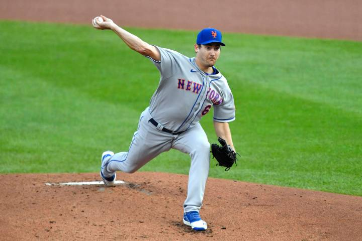 New York Mets starting pitcher Seth Lugo throws to a Toronto Blue Jays batter during the first ...