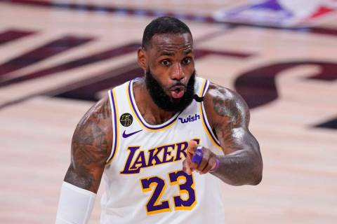 Los Angeles Lakers' LeBron James (23) signals during the second half of an NBA conference semif ...