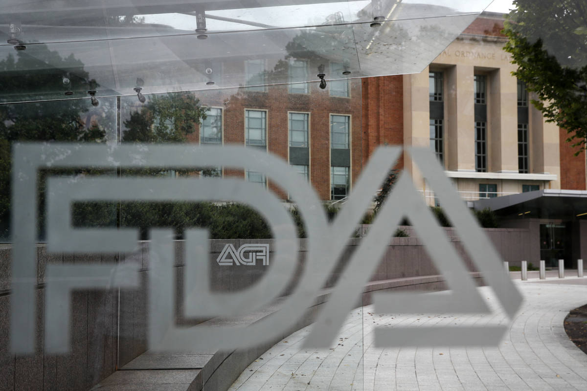 FILE - This Aug. 2, 2018, file photo shows the U.S. Food and Drug Administration building behin ...