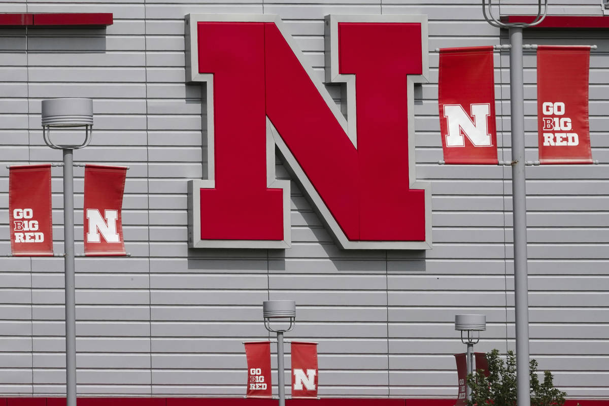 The Nebraska logo and flags incorporating the Big Ten logo are seen outside the Devaney sports ...