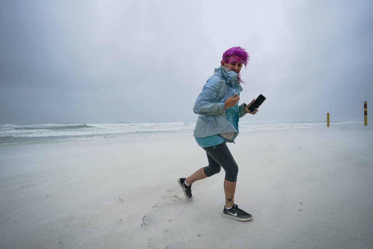 Courtney Watts, of Tuscaloosa, Ala., moves off the beach at Gulf State Park, Tuesday, Sept. 15, ...