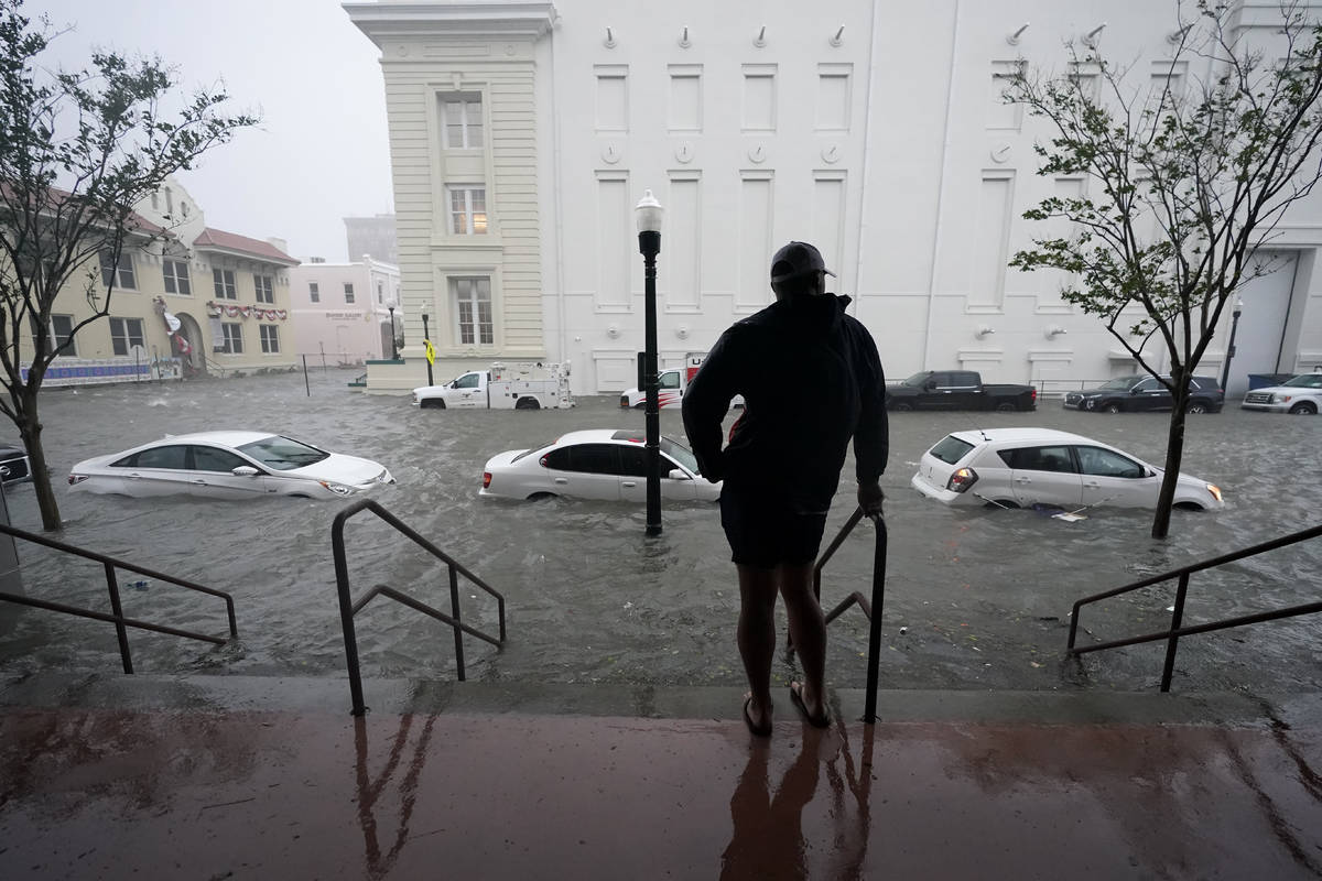 Flood waters move on the street, Wednesday, Sept. 16, 2020, in downtown Pensacola, Fla. Hurrica ...