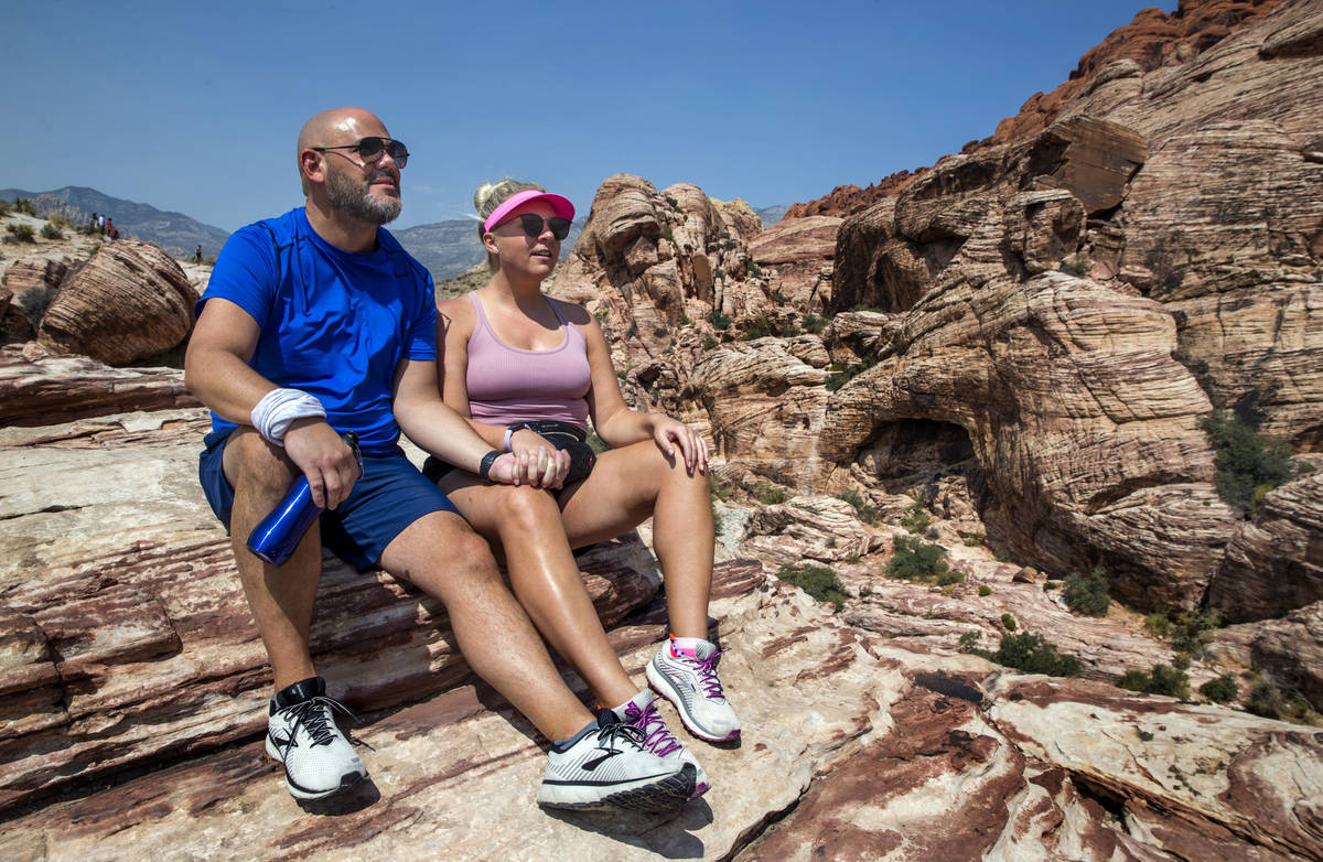 Brian DiCrescenzo, left, and Brittany Breisch of Chicago relax atop a ledge at the Calico 1 tra ...