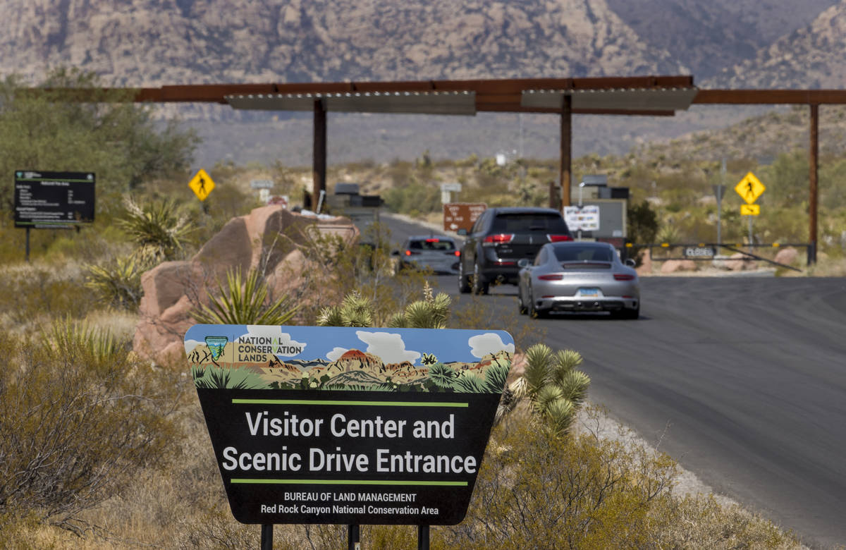 An entrance marker and vehicles for the Red Rock Canyon National Recreation Area which is start ...